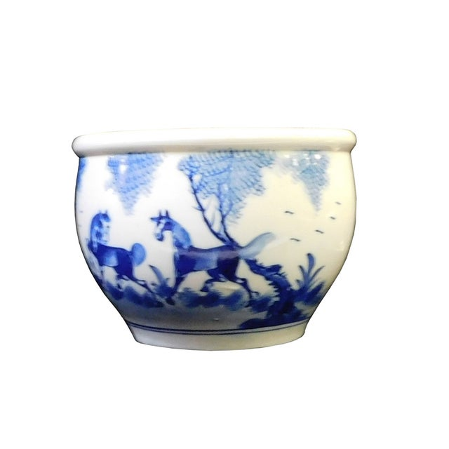 This is a Chinese decorative brush holder / pot in blue and white. It features horses & Chinese calligraphy. Dimensions:...