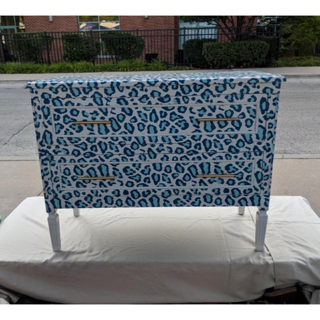 Beautiful, sturdy and a forward thinking dresser all wrapped up in a blue Cheetah print with correspnding dot print on...