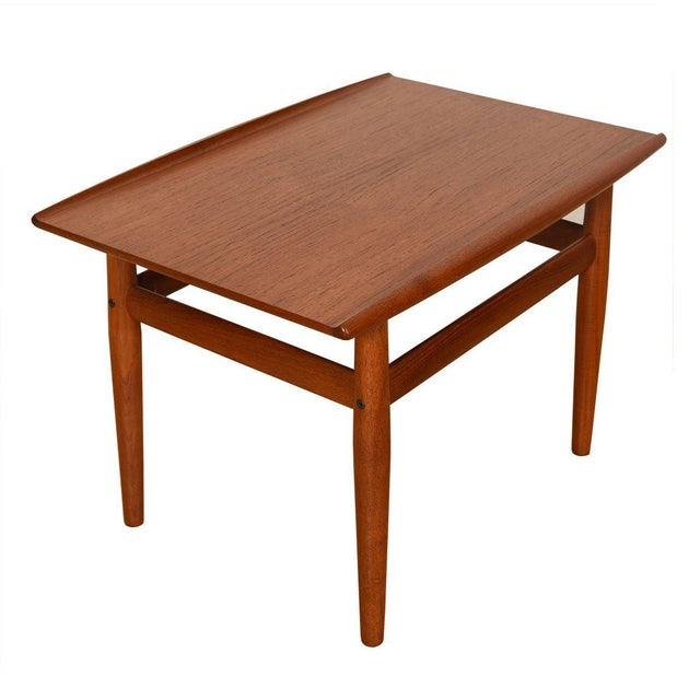 A wonderful Danish Modern end/accent table by Grete Jalk. The raised lip edges are characteristic of Jalk's designs, and...