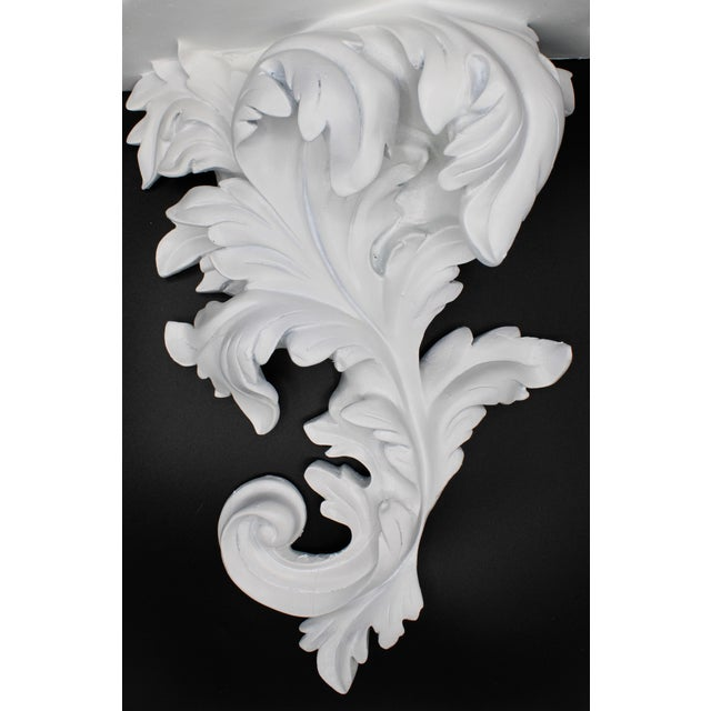 An extra large mid-20th century white acanthus leaf wall shelf. Two available. Ready to hang!