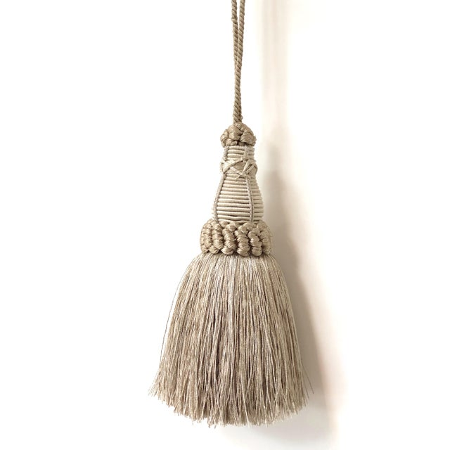 Handmade, silver & pewter colored key tassel with looped ruche, twisted cord and full skirt. I try to get the color as...
