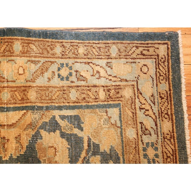 This intriguing carpet features a subdued color pallet of muted blues and golds, as well as a refreshingly unusually...