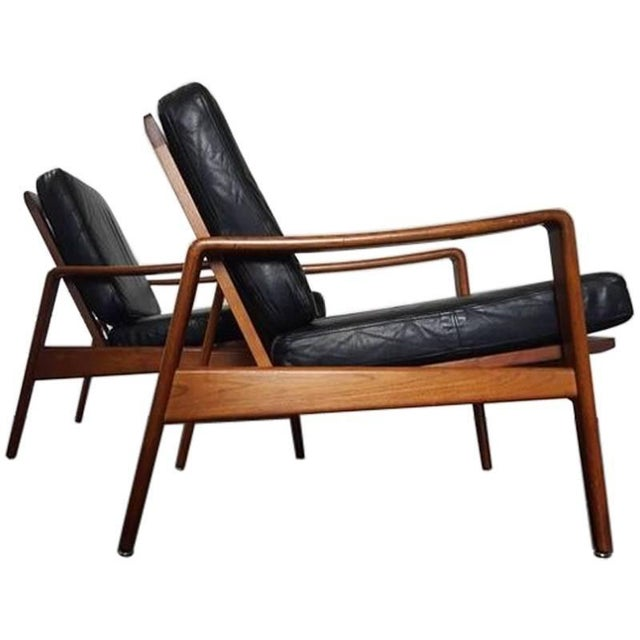 Pair of model 30 lounge chairs by Arne Wahl Iversen for Komfort. Made in Denmark and manufactured in 1960. These chairs...