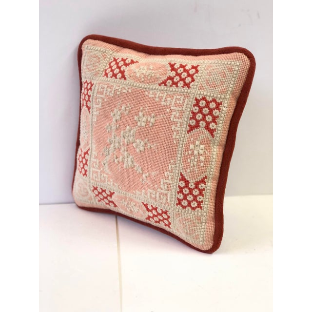 Beautiful vintage throw pillow with a hand needle-pointed front featuring many intricate stitches and depicting a stylized...