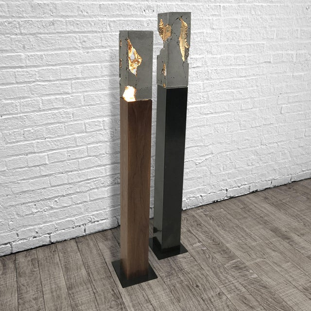 "Referencing Carlo Scarpa, these lights are constructed from a hand-blackened steel base with a cast-concrete ""shade"". The..."