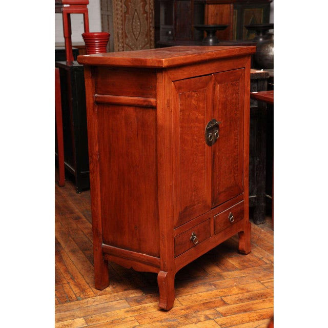 This tall Chinese cabinet was made with natural color lacquered wood in the 19th century. The cabinet showcases a subtle...