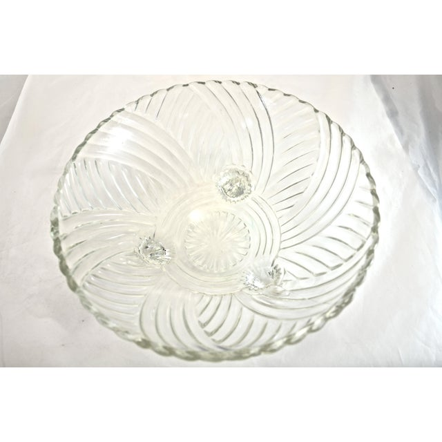 Large vintage sparkling glass bowl with a swirled woven crosshatch pattern atop three feet. No maker's mark.