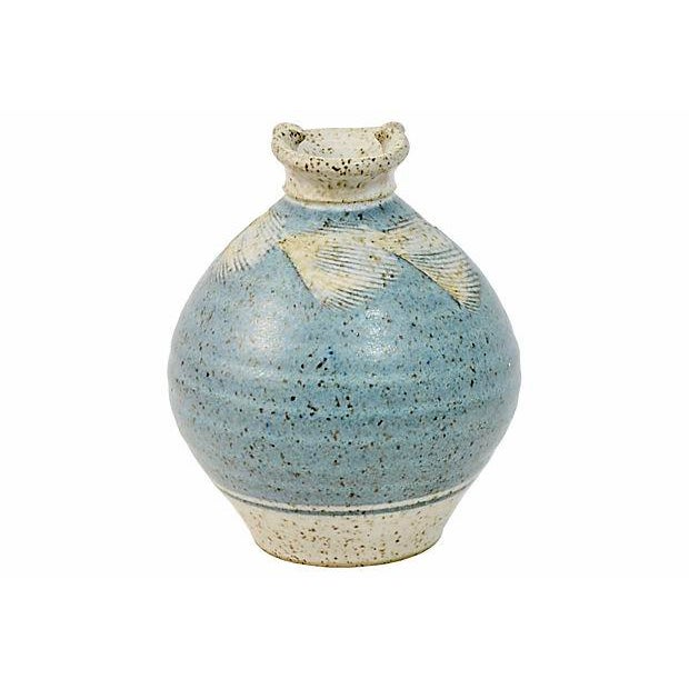 Hand thrown speckled denim blue stoneware studio art pottery vase with pinched lip, incised feather or leaf shoulder and...