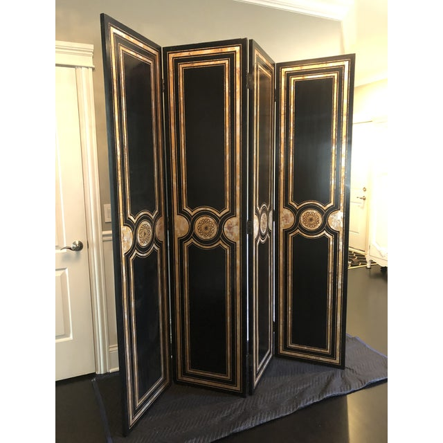 This rare four panel screen by Maitland-Smith features a solid backside and hand painted gold and silver neoclassical...