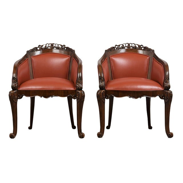 This Pair of 19th Century English Chinossiere Style Bergeres has been fully restored and newly upholstered in a Cognac...