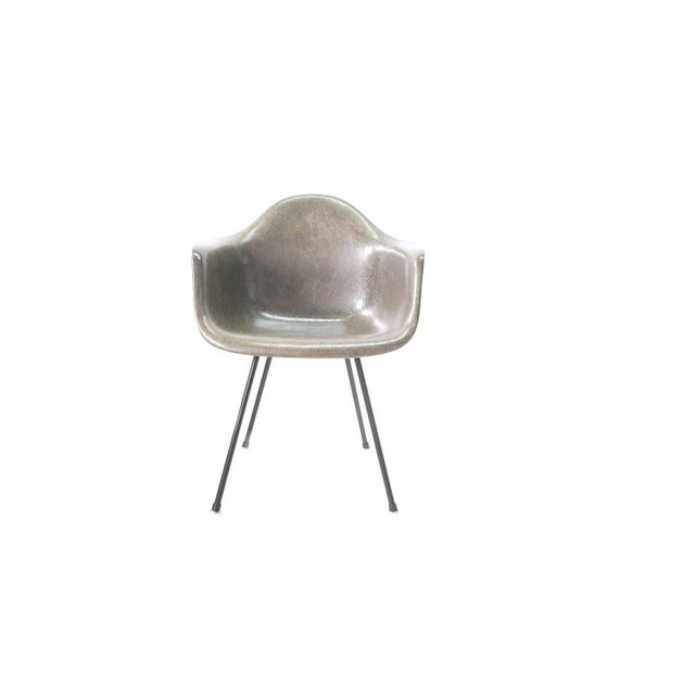 A fully restored rope edge armshell chair, designed by Charles Eames, and produced by Zenith Plastics of California for...