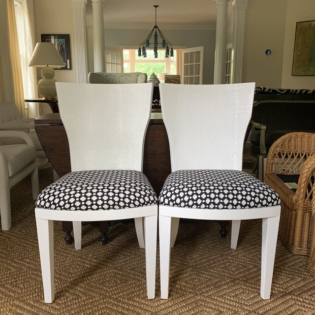 Chic and stylish pair of side chairs or dining chairs made by made goods. Hance white faux shagreen chair. Beautifully...