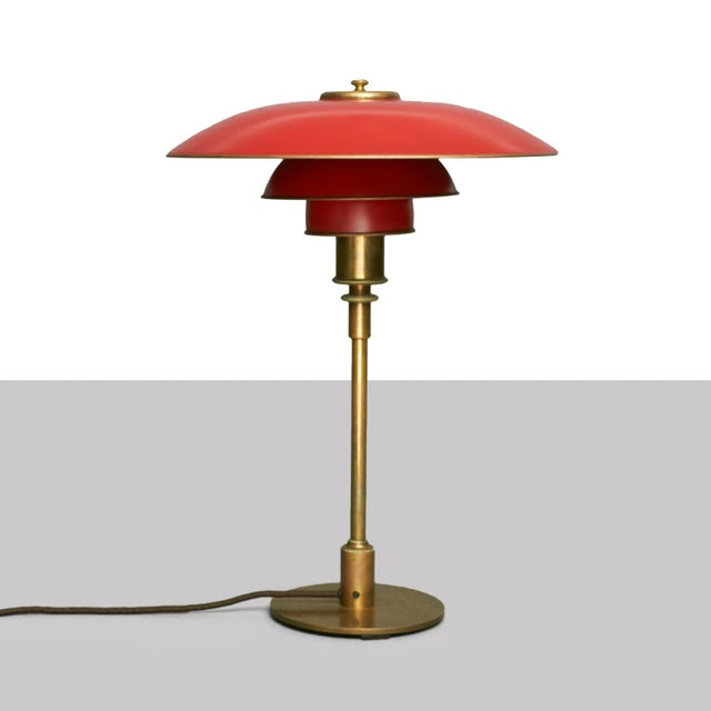 PH 4/3 table lamp with brass frame, red painted copper shades inside with reflector painting. Stamped Pat. Appl....