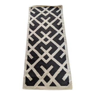 Black and Ivory Tribal Print Rug- 2′8″ × 6′ For Sale