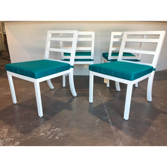 This set of four (4) David Francis Outdoor Aluminum Dining Side Chairs feature an aluminum frame with an epoxy white...