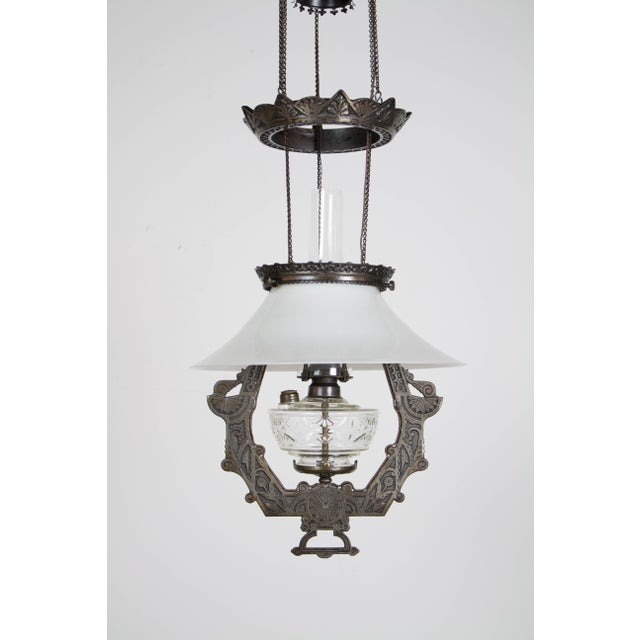 Eastlake Style oil pendant by Lomax. Has original oil font and glass shade. Completely restored and rewired, ready to...