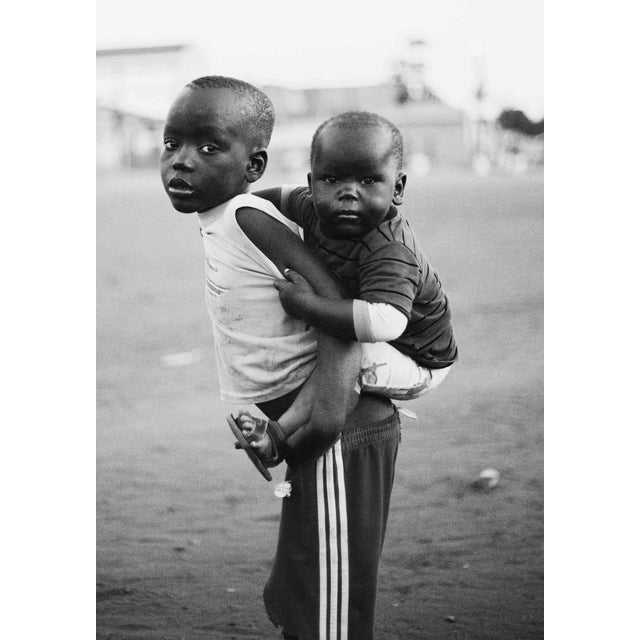 """Contemporary Photography """"Family Portrait"""" by Douglas Condzo An older brother babysitting his younger brother. It is..."""