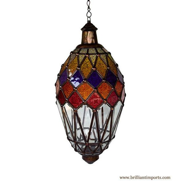 A glass lantern with kaleidoscope accents inspired by Morocco, made in Bali. One day, Suparta and I had a happy encounter...