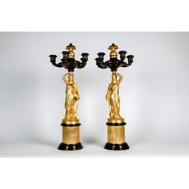 Antique pair of French porcelain / bronze five arms candelabras. Each candelabras is in excellent antique condition. Minor...