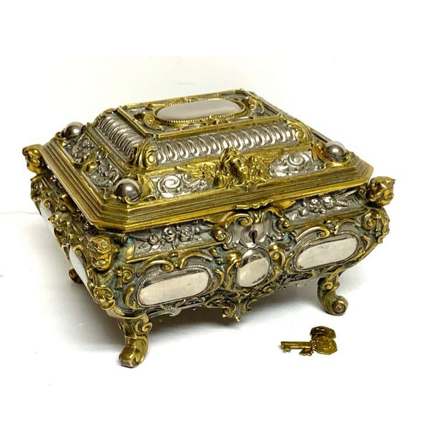 Magnificent silvered bronze and ormolu jewelry/table box, a substantial heavy weight box with Intricate detail with the...