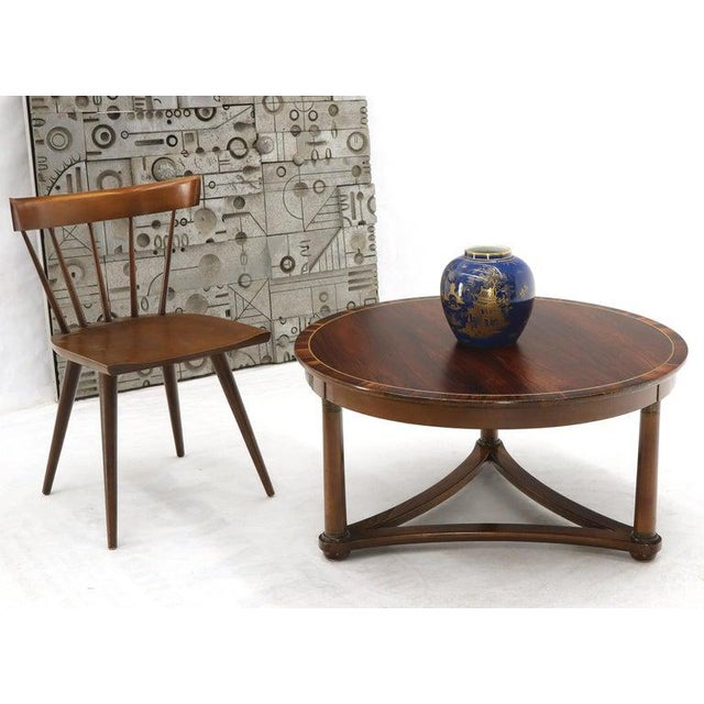 Sharp looking neoclassical almost Mid-Century Modern Danish design banded rosewood coffee cocktail table. Unsigned...
