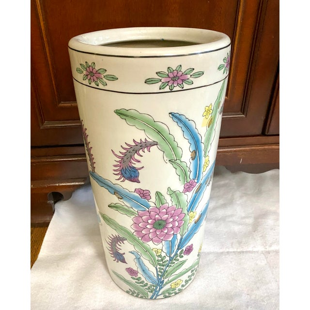 Bright and colorful umbrella stand, made in China. The pattern is of a Mum and Caterpillars with pink, blue, green,...