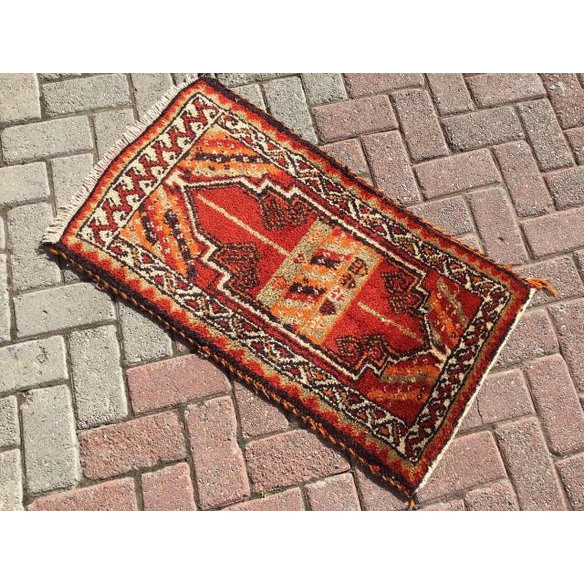 This gorgeous hand-knotted rug was made in about 1960s by Anatolian tribals. Collectible rug is made with all hand spun...