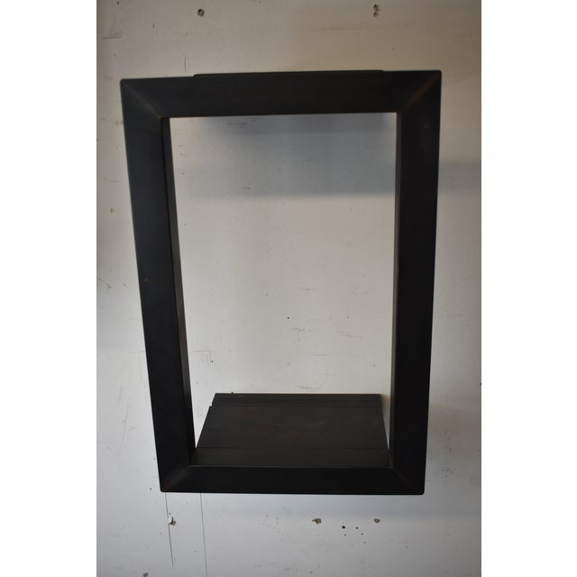 Blackened steel wall shelf with bronze accents frame was made to showcase small items that are not otherwise practical to...