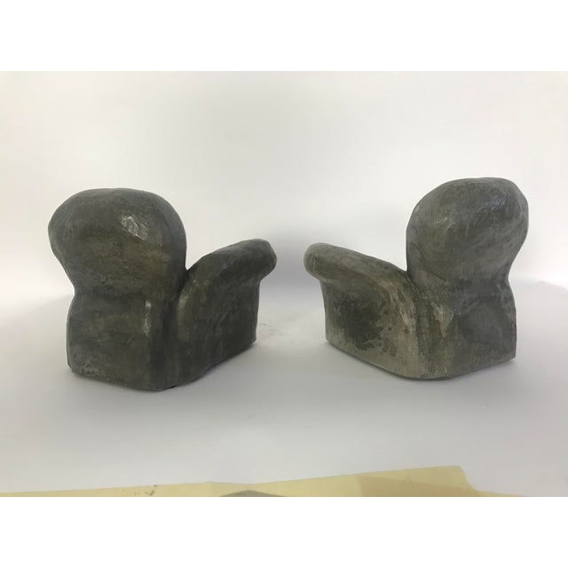 This is a pair of ceramic sculptures in the form of two miniature lounge chairs. They are a great homage to the most...
