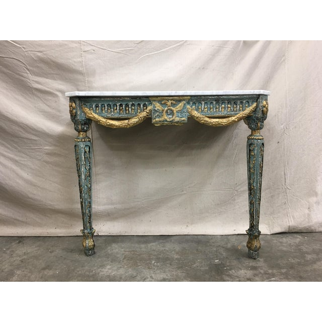 19th C French marble top painted console table. This lovely accent piece features a distressed patina of blue and gold,...