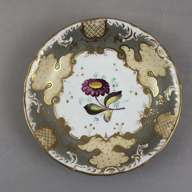 English teacup and saucer is beautiful hand painted with incredible detailing and colors. The gold, silver, white and...