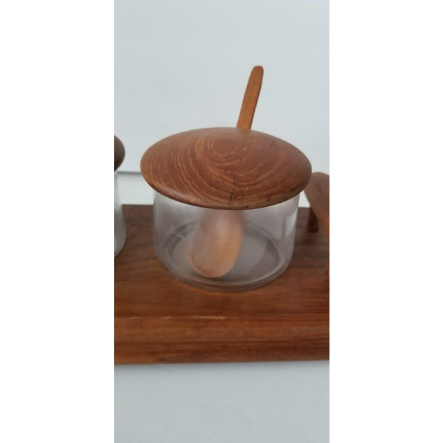 You are viewing beautiful mid century teak footed serving tray with handles by Good Wood. This comes with 2 glass bowls...