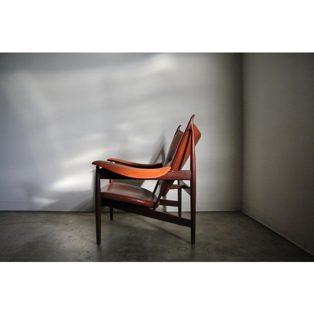 """Iconic """"Chieftain"""" chair in mahogany and leather by Finn Juhl and manufactured by Interior Crafts, circa 1989. Originally..."""