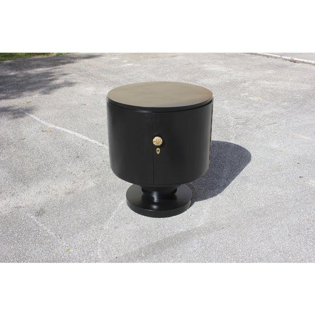 Beautiful French Art Deco cylinder dry bar black ebonized Circa 1940s. Made of mahogany, the mahogany wood has been...