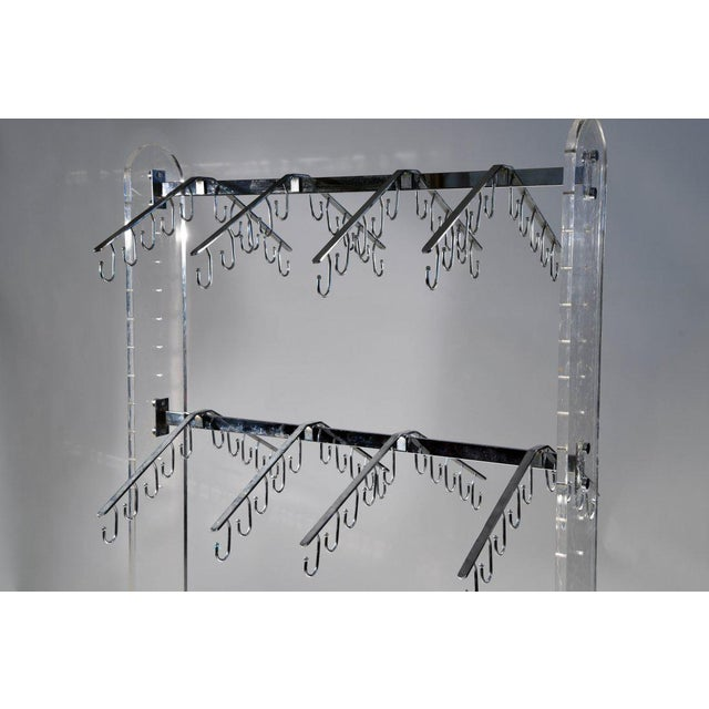 This unique chrome and lucite rack can be used as a store fixture or a closet organizer at home. Featuring two rows of...