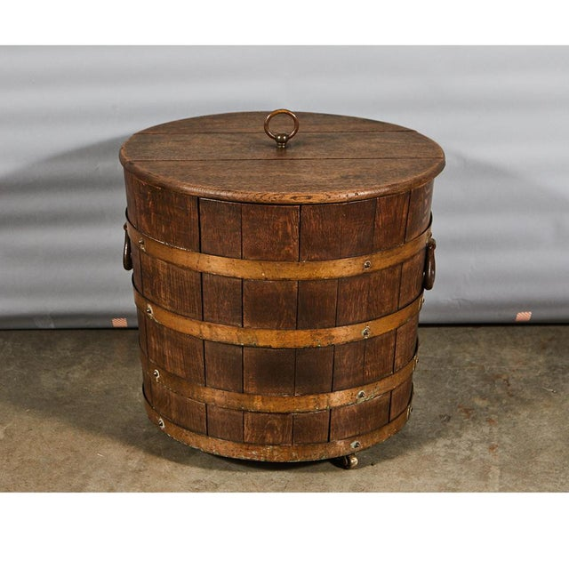 This handsome English oak bucket with a lid has brass bands and studs, iron handles and a removable tin liner. It sits on...