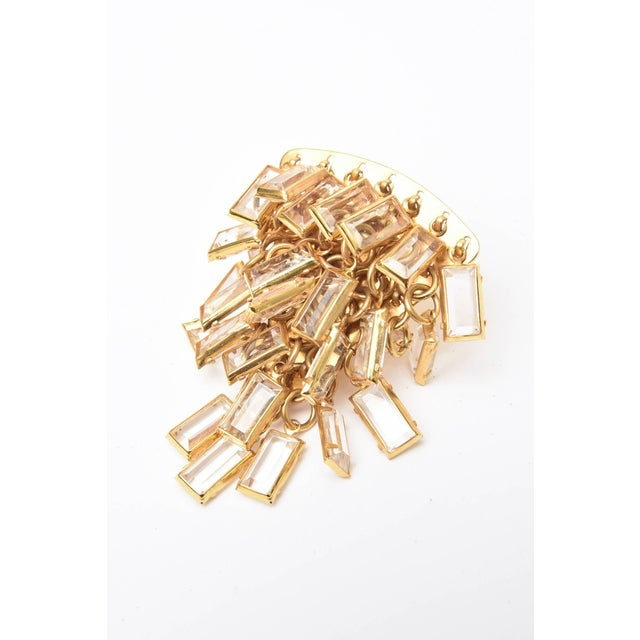 These wonderful and dramatic Italian cascading pair of clip on earrings are composed of tiered small glass chips...