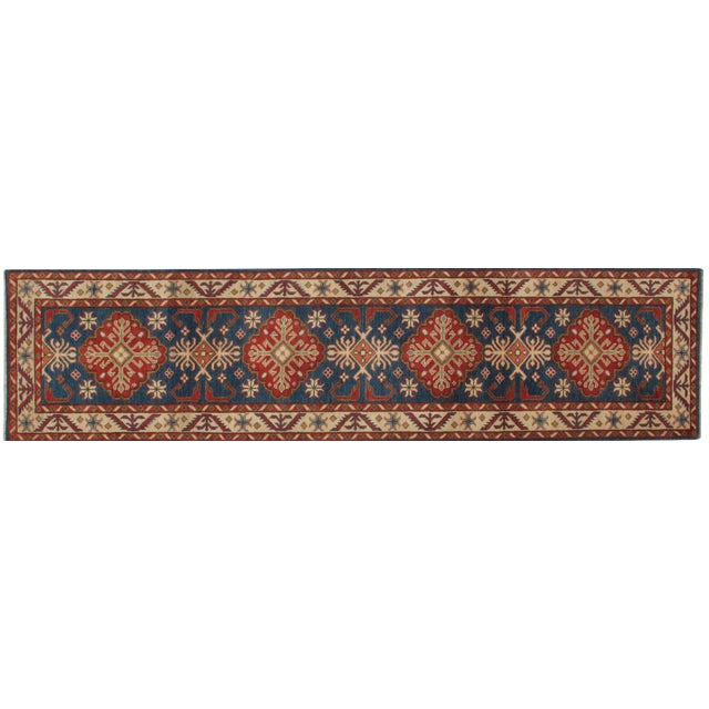 Featuring a plush wool pile, this handmade Kazak runner is in mint condition.