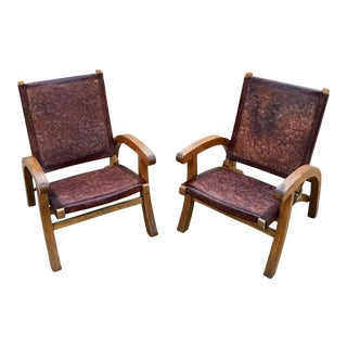 Willam Spratling Style Tooled Leather Lounge Chairs - a Pair