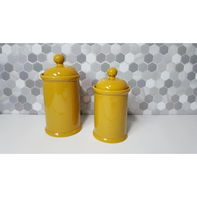 Vintage 1970s Peasant Village Canister with Lid and Handle created and imported by Mittledorfer Strauss. This canister set...