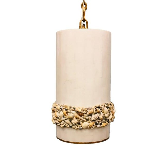 Century Furniture's found natural sea shells surrond this bone inlay pendant with gold trim along the base. The bone inlay...
