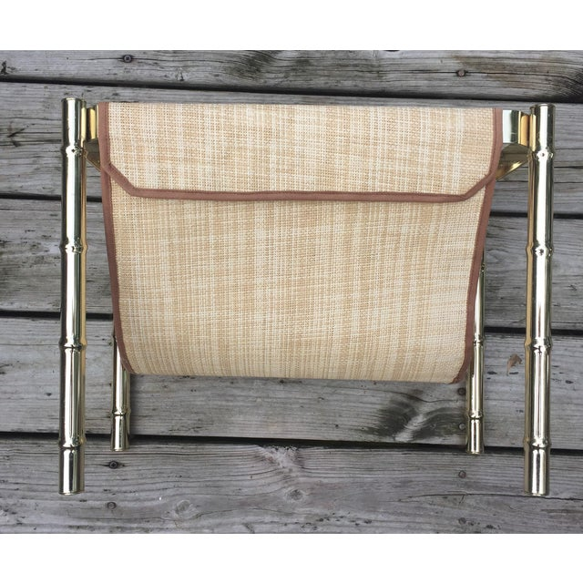 Simple Brass Faux Bamboo Magazine Rack. The fabric loops over the frame and is secured with strong Velcro. As far as...