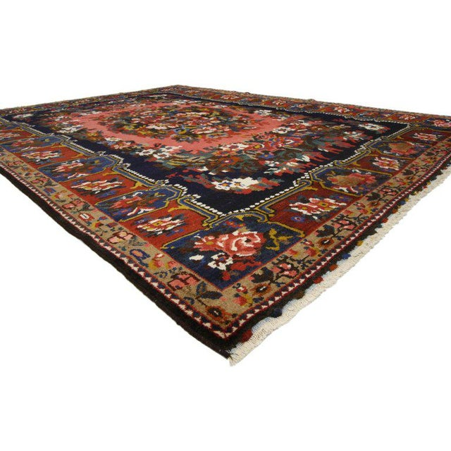 75358 Victorian style Vintage Persian Bakhtiari rug with Floral Design Pearl Border 07'03 x 09'09. This hand knotted wool...