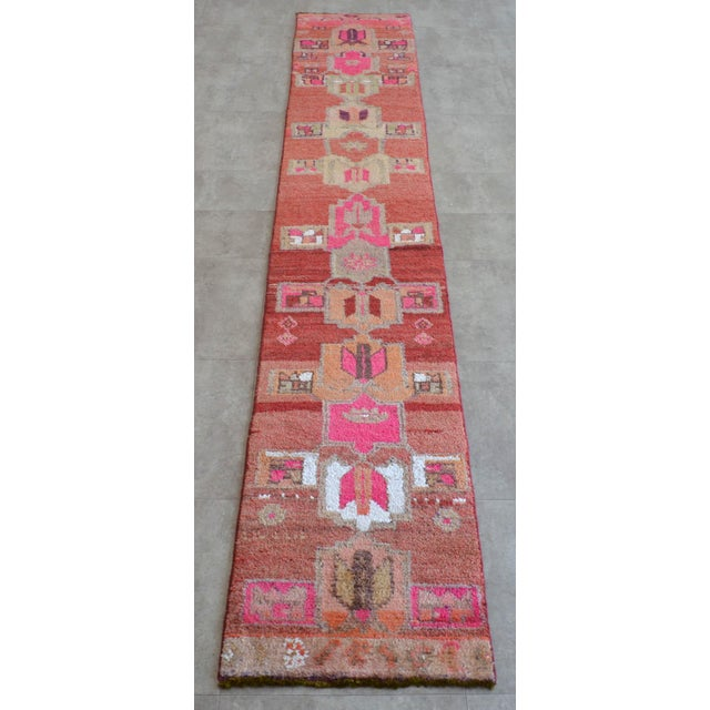 Vintage 1960s distressed Turkish Oushak rug runner. with wavy rose vale field and shades of hot pink, white and gray...