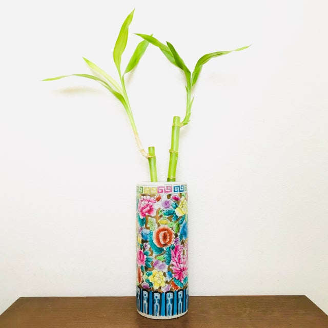 We love the bright floral pattern and pops of gold in this vase! Age unknown.
