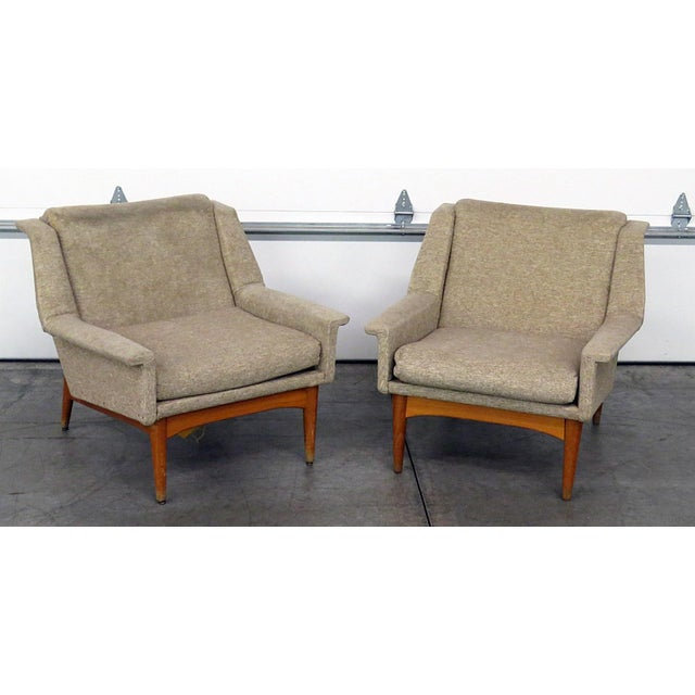 Pair of Danish modern upholstered lounge chairs with upholstery.