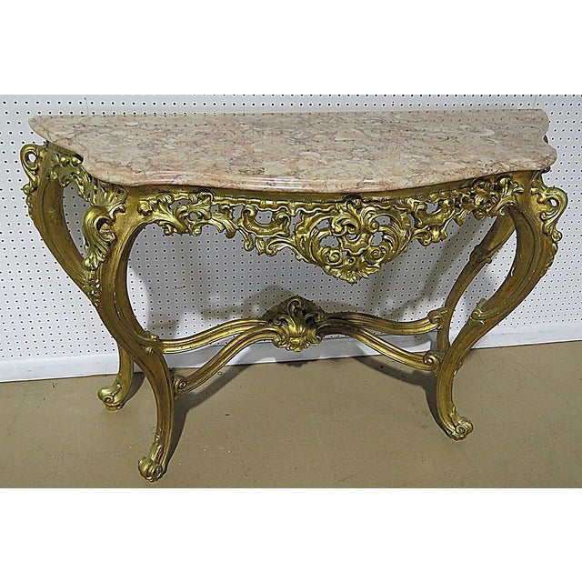 """Florentine style marble top console table and mirror with distressed gilt. The mirror measures 48""""h x 31""""w x 5""""d. The..."""