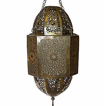 Moroccan hand-carved brass geometric-design chandelier with opaque and amber glass. Wired, can take a 100 watt bulb. Drop...