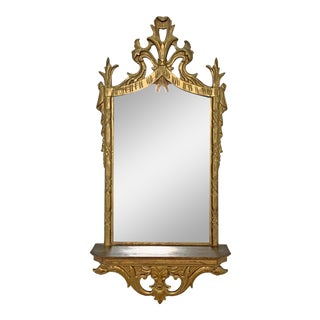 C. 1950s Hollywood Regency Style Italian Carved Giltwood Mirror With Under Shelf For Sale