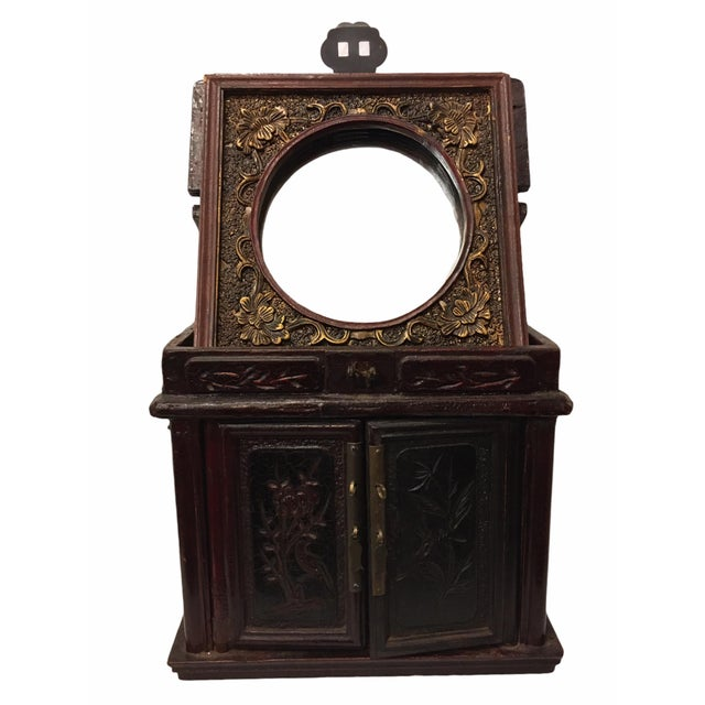 Beautiful antique Chinese jewelry box. Features an ornamented rosewood body of floral designs with two storage drawers and...